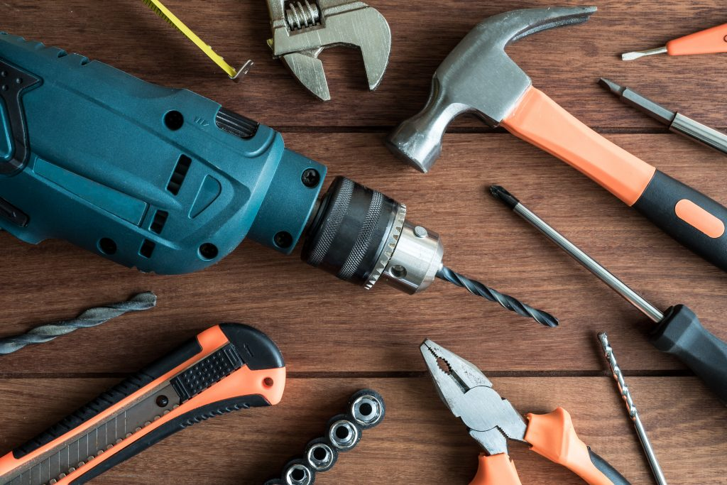 Set of work tools on wooden background, Top view