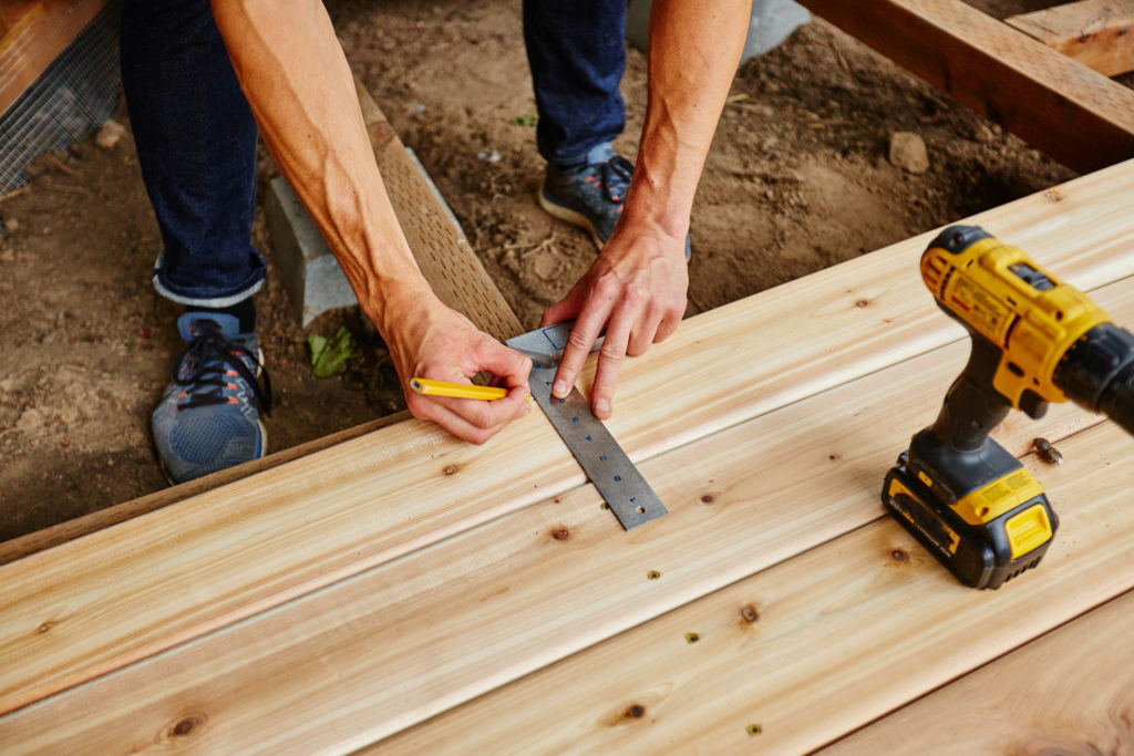Wood is a cheaper option to lower how much a new deck costs.